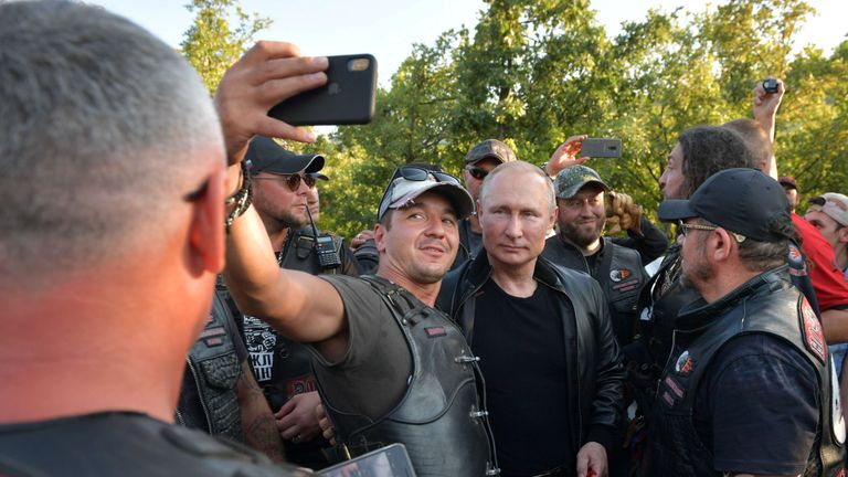 """Russia's President Vladimir Putin poses for a picture with participants of a bike show organized by motorcycling club """"Night Wolves"""" in Sevastopol, Crimea August 10, 2019. Sputnik/Alexei Druzhinin/Kremlin via REUTERS ATTENTION EDITORS - THIS IMAGE WAS PROVIDED BY A THIRD PARTY."""