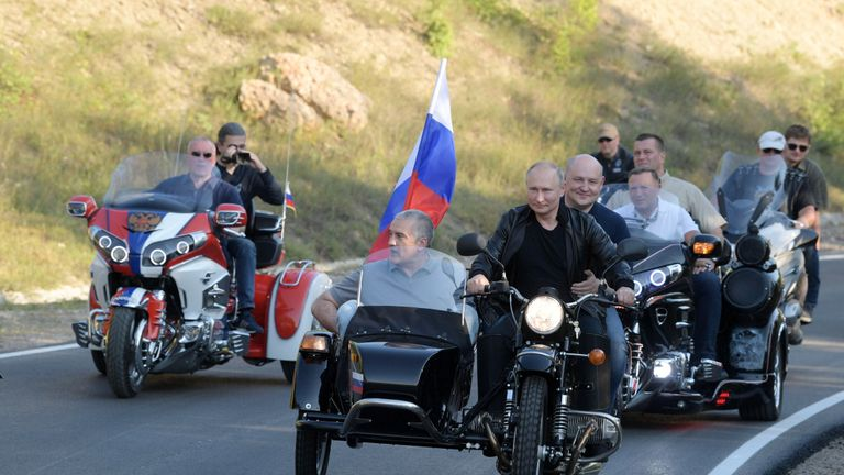 "Russia's President Vladimir Putin, Acting Governor of Sevastopol Mikhail Razvozhayev and head of Crimea Sergei Aksyonov ride an Ural motorcycle as they take part in a bike show organized by  motorcycling club ""Night Wolves"" in Sevastopol, Crimea August 10, 2019. Sputnik/Alexei Druzhinin/Kremlin via REUTERS  ATTENTION EDITORS - THIS IMAGE WAS PROVIDED BY A THIRD PARTY."