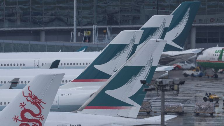 Cathay Pacific (C) passenger planes are seen on the tarmac at Hong Kong's international airport on August 16, 2017. The city's flagship airline Cathay Pacific was expected to announce its half-year results later in the day. / AFP PHOTO / Anthony WALLACE        (Photo credit should read ANTHONY WALLACE/AFP/Getty Images)