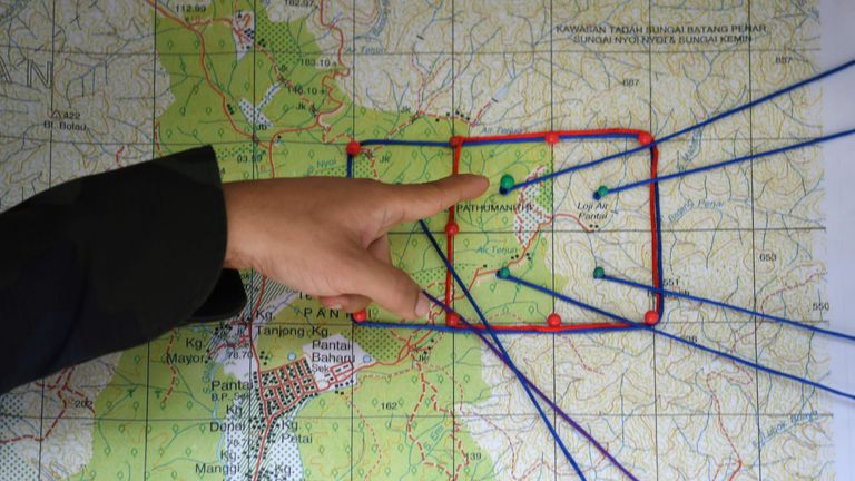 A Royal Malaysian Police officer points to a map showing the search and rescue operation area for the missing 15-year-old Franco-Irish teenager Nora Quoirin in Seremban on August 8, 2019. - Quoirin, who lives in London, went missing on August 4 after checking in with her family to the Malaysian Dusun Resort in Seremban, about an hour from the capital Kuala Lumpur. (Photo by Mohd RASFAN / AFP) (Photo credit should read MOHD RASFAN/AFP/Getty Images)