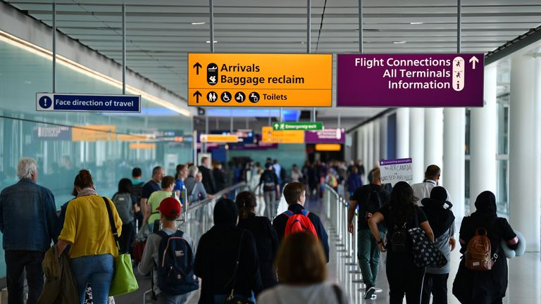 Passengers make their way towards the Baggage reclaim and flight connections in Terminal 2 having arrived at Heathrow Airport in London on July 16, 2019 (Photo by Daniel LEAL-OLIVAS / AFP)        (Photo credit should read DANIEL LEAL-OLIVAS/AFP/Getty Images)