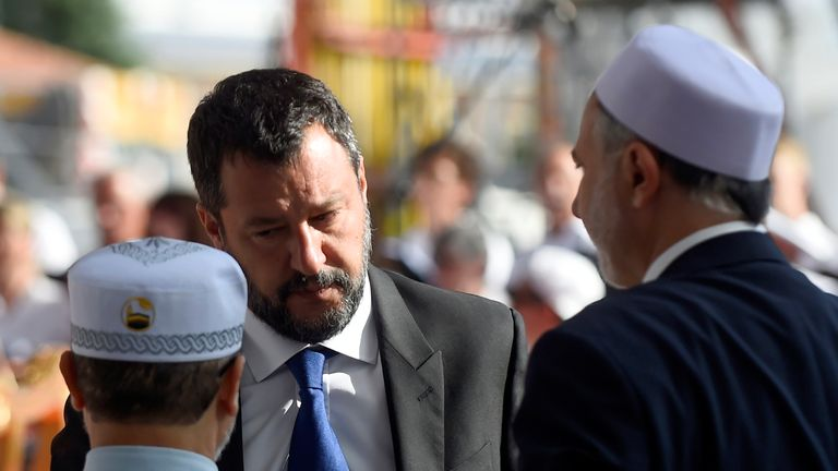 Italian Deputy Prime Minister and Interior Minister Matteo Salvini talks with relatives of one of the victims during the ceremony marking the first anniversary of the collapse of a motorway Morandi Bridge that killed 43 people in Genoa, Italy, August 14, 2019. REUTERS/Massimo Pinca