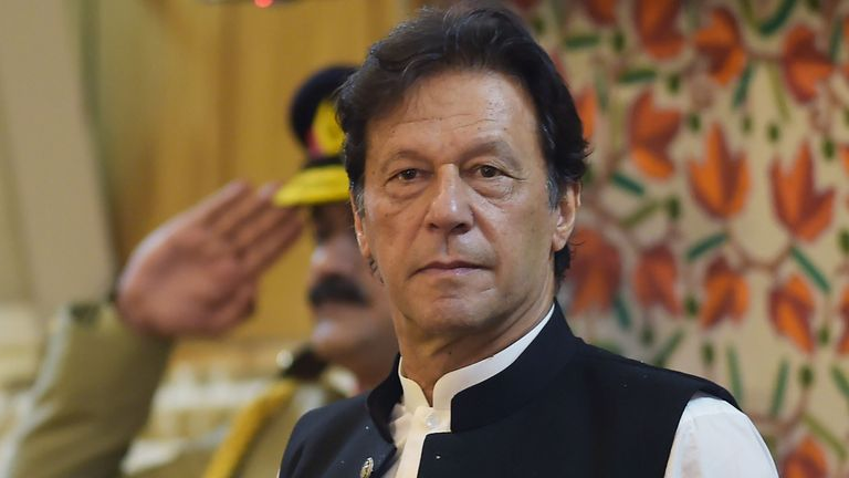 Pakistan's Prime Minister Imran Khan listens to the national anthem as he arrives at the legislative assembly in Muzaffarabad, the capital of Pakistan-controlled Kashmir on August 14, 2019 to mark the country's Independence Day. - His visit to mark the country's Independence Day comes more than a week after Indian Prime Minister Narendra Modi delivered a surprise executive decree to strip its portion of the Muslim-majority Himalayan region of its special status. (Photo by AAMIR QURESHI / AFP)        (Photo credit should read AAMIR QURESHI/AFP/Getty Images)