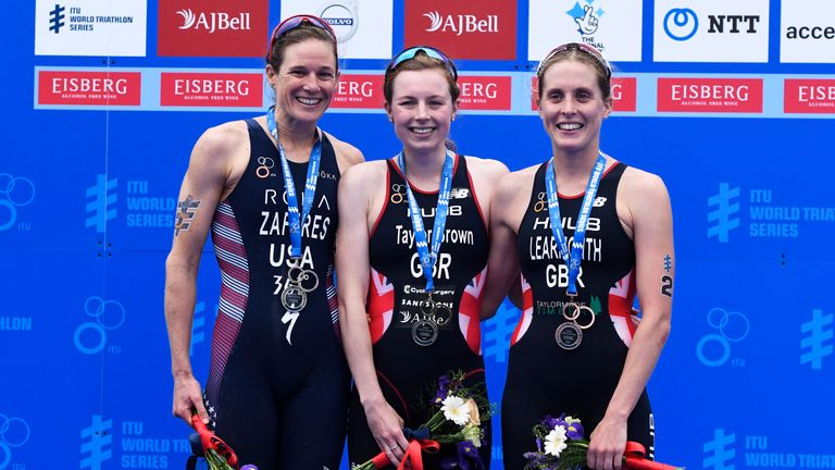LEEDS, ENGLAND - JUNE 09:  First placed Georgia Taylor-Brown (C) of Great Britain, second placed Katie Zaferes (L) of the United States and third placed Jessica Learmonth (R) of Great Britain celebrate on the podium after the AJ Bell World Triathlon - Leeds on June 09, 2019 in Leeds, England. (Photo by George Wood/Getty Images)