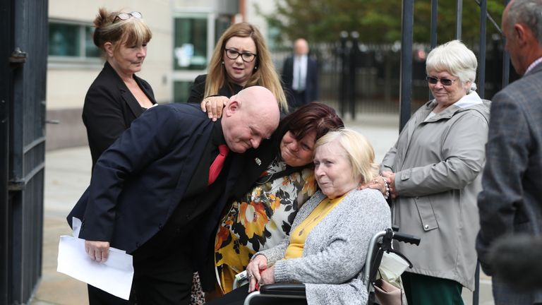 Bloody Sunday relative Kate Nash (right) looks on as Danny Bradley (left) hugs his sisters Martina Davis and MayMcDaid outside Laganside Courts in Northern Ireland, after a coroner ruled that their brother Seamus was unjustifiably killed by a British Soldier, as he ran across a field in Londonderry in 1972.