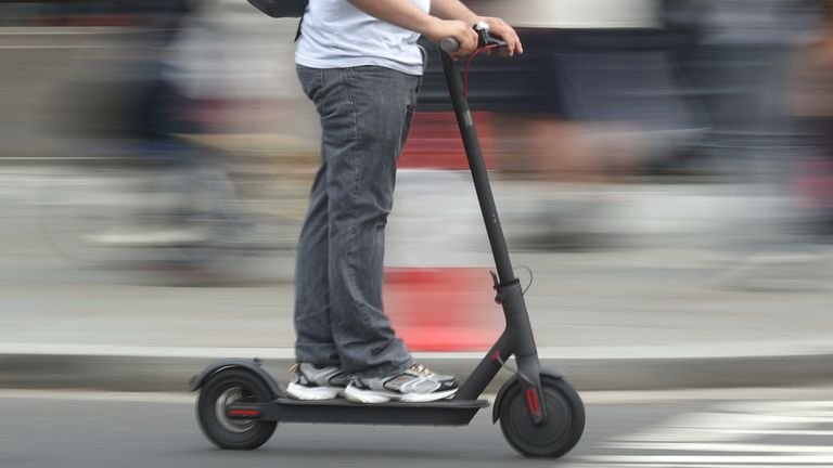 File photo dated 18/07/19 of a man using an electric scooter. London's transport authority has said a Government review which could lead to electric scooters being allowed on UK roads should be accelerated.