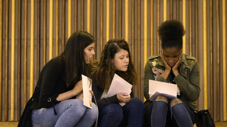 Embargoed to 0001 Friday May 17 File photo dated 23/08/18 of students collecting their GCSE results. New research suggests encounters with the world of work have a positive impact on young people's GCSE results - with lower achievers and the less engaged benefiting most.