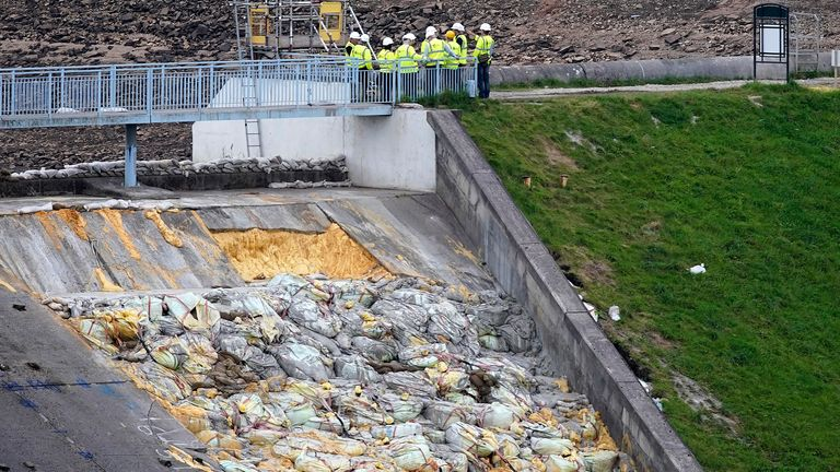WHALEY BRIDGE, ENGLAND - AUGUST 21: Work continues at the Whaley Bridge Dam site to shore up the damaged dam on August 20, 2019 in Whaley Bridge, England. Approximately 1,500 residents of the town's 6,500 population were forced to leave their homes after the partial collapse of the dam at Toddbrook Reservoir, in Derbyshire, at the beginning of August. Engineers have cleared the reservoir of water and installed pumps to keep the reservoir dry during operations. (Photo by Christopher Furlong/Getty Images)