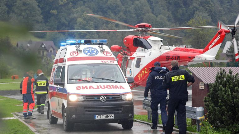 A TOPR (Tatra Volunteer Search and Rescue) helicopter and an ambulance are seen as rescuers conduct a rescue operation after a thunderstorm in the Tatra Mountains, in Zakopane, Poland August 22, 2019. Agencja Gazeta/Marek Podmokly via REUTERS   ATTENTION EDITORS - THIS IMAGE WAS PROVIDED BY A THIRD PARTY. POLAND OUT. NO COMMERCIAL OR EDITORIAL SALES IN POLAND.