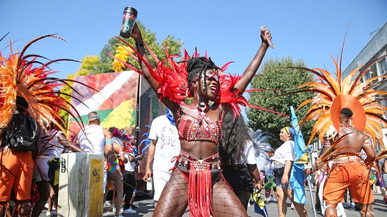 A reveler dances during the the Notting Hill Carnival in west London.