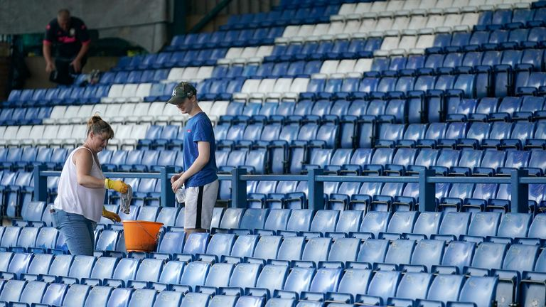 BURY, ENGLAND - AUGUST 27: Bury FC fans and hundreds of volunteers clean their stadium as they await a decision on the future of the club on August 27, 2019 in Bury, England. Bury Football Club had an eleventh hour offer to buy the club by C&N Sporting Risk Ltd. The deadline by the English Football League (EFL)  was extended to today for the club to prove it can operate and meet the criteria of the EFL. (Photo by Christopher Furlong/Getty Images)