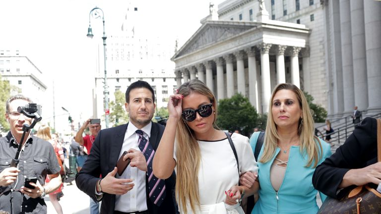Jennifer Araoz (C), one of deceased financier Jeffrey Epstein's alleged victims, and her attorney Kimberly Lerner (R), finish speaking to the press outside the US Federal Court on August 27, 2019 in New York. - Jeffrey Epstein, 66, had been charged with sex trafficking of minors, a case that grew out of reports that he had been treated extremely lightly when he was arrested in Florida in 2006 for sex acts with underage girls. (Photo by Yana Paskova / AFP)        (Photo credit should read YANA PASKOVA/AFP/Getty Images)