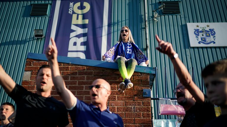 BURY, ENGLAND - AUGUST 23: Fans chant songs as they stand outside Bury Football Club awaiting a rescue plan for the ill-fated club on August 23, 2019 in Bury, England. Bury Football Club could be expelled from the English Football League in less than 24 hours unless it can prove to officials it can pay its debts.  (Photo by Christopher Furlong/Getty Images)