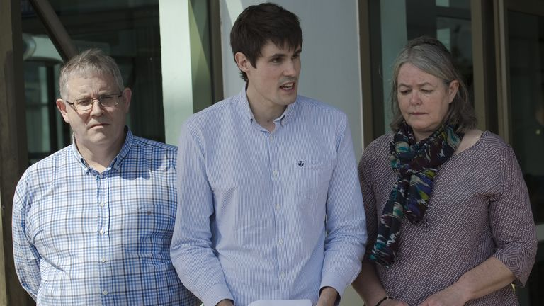 Sue Miller (R), Ian Miller (L), and Michael Miller (C) - the respective mother, father and brother of slain British backpacker David Miller - make a brief statement to the media after the verdict in the murder trial of David Miller, at the Koh Samui Provincial Court in Koh Samui on December 24, 2015. The Thai court on December 24 sentenced Myanmar migrant workers Zaw Lin and Win Zaw Tun to death for murdering a pair of British holidaymakers, David Miller and Hannah Witheridge, on the nearby Thai island of Koh Tao in 2014, in a case that sullied the kingdom's reputation as a tourist haven and raised questions over its justice system. AFP PHOTO / Nicolas ASFOURI / AFP / NICOLAS ASFOURI        (Photo credit should read NICOLAS ASFOURI/AFP/Getty Images)