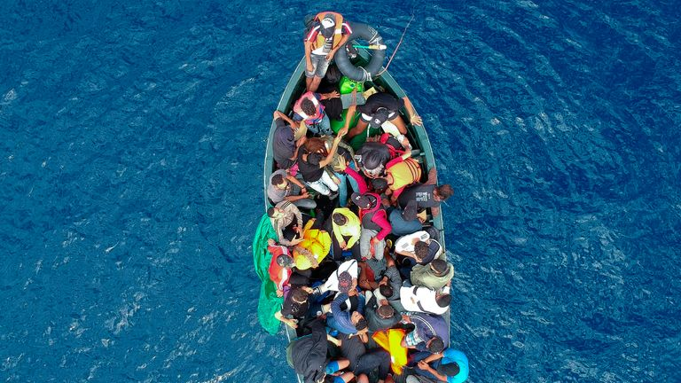 TOPSHOT - An aerial photo shows a boat carrying migrants stranded in the Strait of Gibraltar before being rescued by the Spanish Guardia Civil and the Salvamento Maritimo sea search and rescue agency that saw 157 migrants rescued on September 8, 2018. - While the overall number of migrants reaching Europe by sea is down from a peak in 2015, Spain has seen a steady increase in arrivals this year and has overtaken Italy as the preferred destination for people desperate to reach the continent. Over 33,000 migrants have arrived in Spain by sea and land so far this year, and 329 have died in the attempt, according to the International Organization for Migration. (Photo by Marcos Moreno / AFP)        (Photo credit should read MARCOS MORENO/AFP/Getty Images)