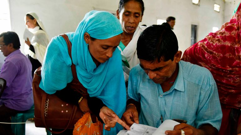 "People check their names on the final list of the National Register of Citizens (NRC) at Buraburi village in Morigaon district of Assam on August 31, 2019. - Almost two million people in northeast India were left facing statelessness on August 31 after the state of Assam published a citizenship list aimed at weeding out ""foreign infiltrators"", in a process the central government wants to replicate nationwide. (Photo by David TALUKDAR / AFP)        (Photo credit should read DAVID TALUKDAR/AFP/Getty Images)"