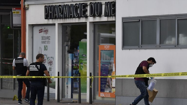 Police officers look for evidence in front of a pharmacy in Villeurbanne on the outskirts of Lyon, south-eastern France on August 31, 2019, after a knife attack which has left one dead and six injured. - Two men, one armed with a knife and the other with a skewer, carried out the attack in Villeurbanne in southeastern France, the official said, without giving further details on the motive for the stabbing. (Photo by PHILIPPE DESMAZES / AFP)        (Photo credit should read PHILIPPE DESMAZES/AFP/Getty Images)