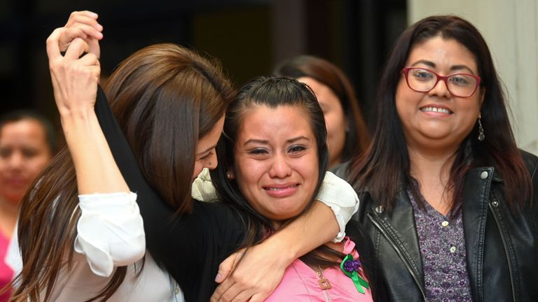 Rape victim Evelyn Hernandez (C) celebrates with her lawyers after being cleared of murder after giving birth to a stillborn baby at home in 2016
