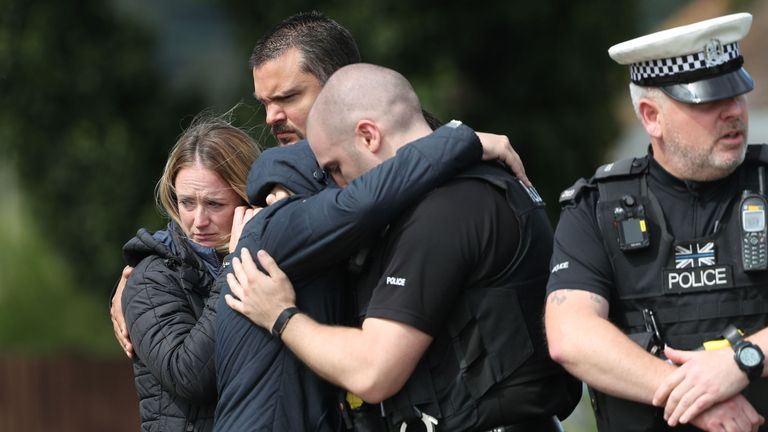 Members of the Thames Valley and Hampshire Roads Policing Team pay their respects at the scene near where PC Andrew Harper was killed