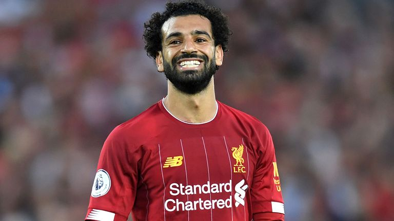 Liverpool's Mohamed Salah comforts young fan floored by streetlamp