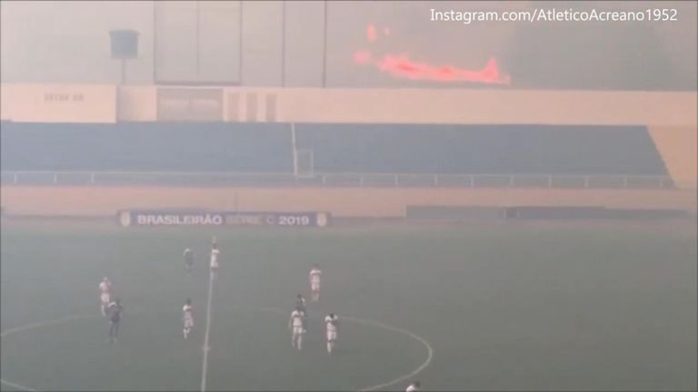 A league soccer game on the edge of the Amazon rainforest was forced to stop for a time due to smoke from a nearby forest fire
