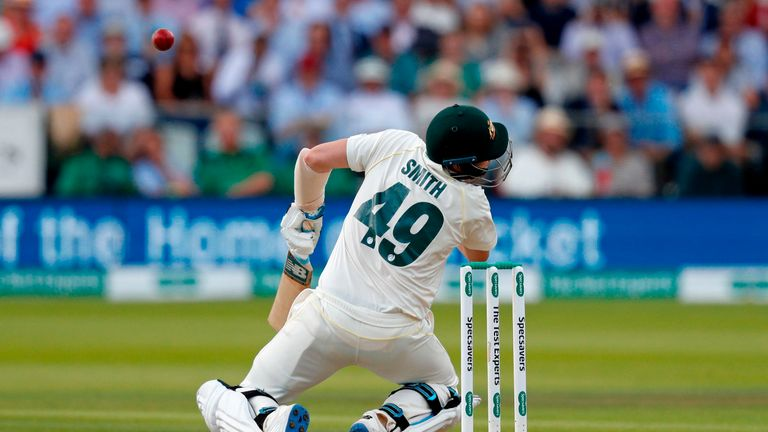 Australia's Steve Smith falls to the ground after being hit in the head by a ball off the bowling of England's Jofra Archer (unseen) during play on the fourth day of the second Ashes cricket Test match between England and Australia at Lord's Cricket Ground in London on August 17, 2019