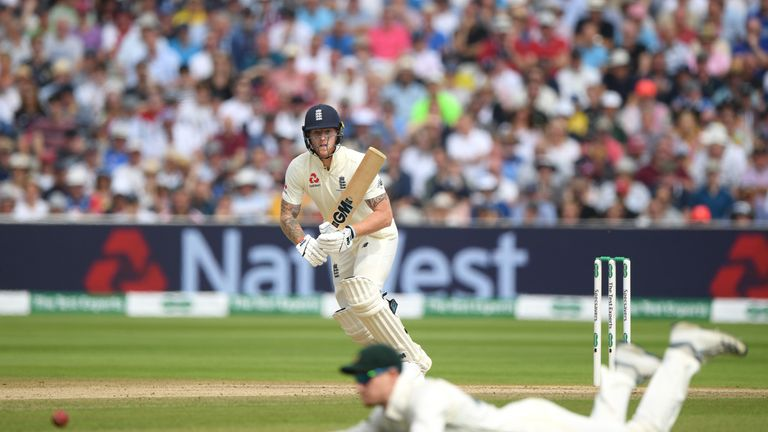 England batsman Ben Stokes picks up a run despite the dive of Cameron Bancroft during day three of the first Test