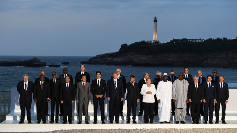 French President Emmanuel Macron, U.S. President Donald Trump, Japan's Prime Minister Shinzo Abe, Britain's Prime Minister Boris Johnson, German Chancellor Angela Merkel, Canada's Prime Minister Justin Trudeau and Italy's acting Prime Minister Giuseppe Conte pose for a family photo with invited guests during the G7 summit in Biarritz, France, August 25, 2019