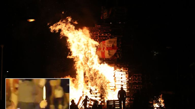 A knife is seen being brandished in social media footage (inset) from the scene of a bonfire in Belfast