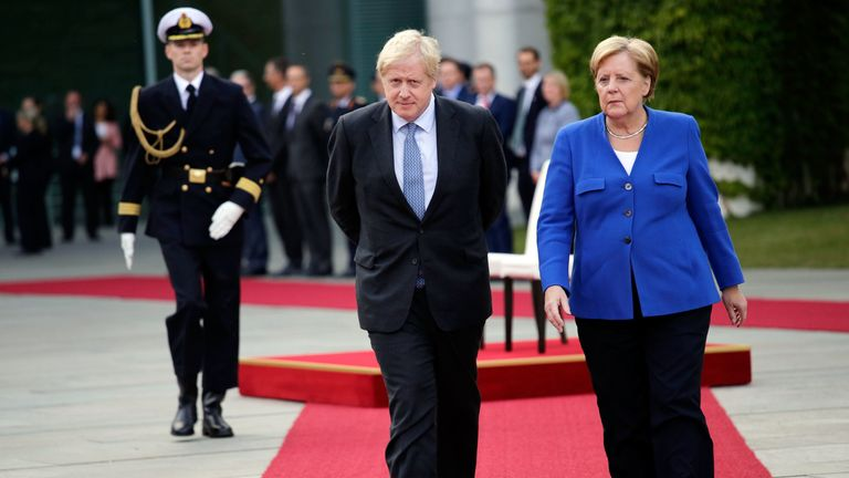 Boris Johnson and German Chancellor Angela Merkel in Berlin