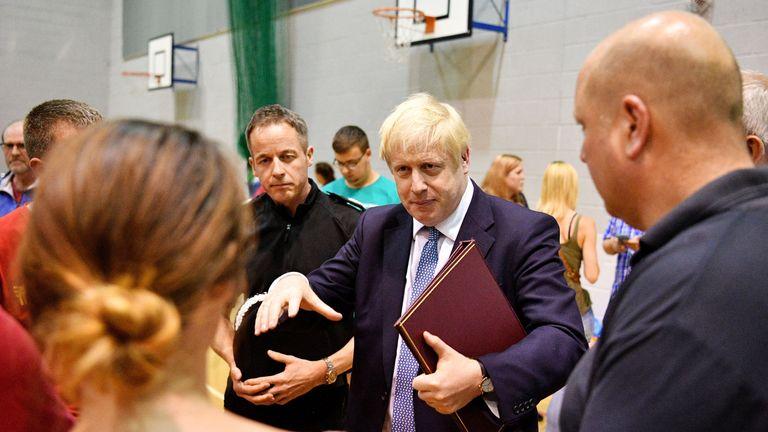 Boris Johnson meeting local residents and rescue crews near Whaley Bridge