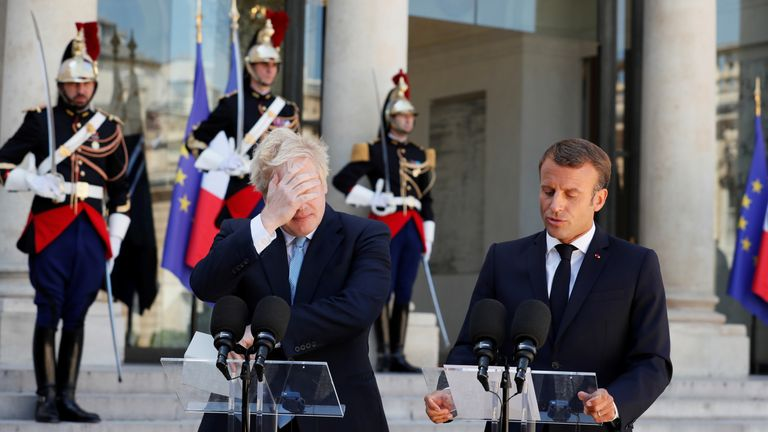 French President Emmanuel Macron and British Prime Minister Boris Johnson deliver a joint statement before a meeting on Brexit at the Elysee Palace