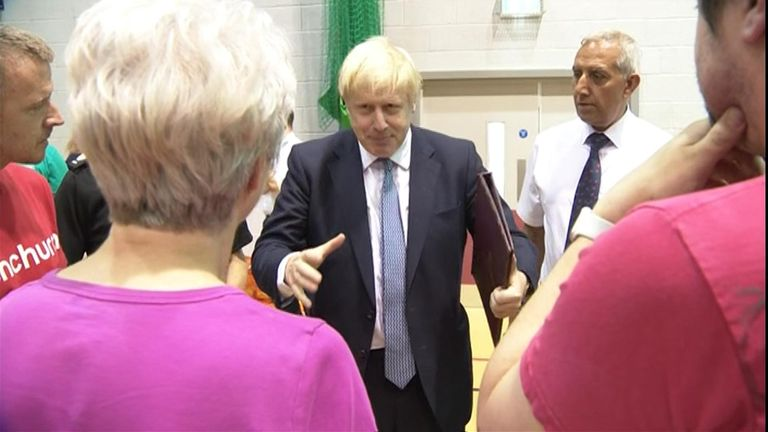 Boris Johnson met residents and emergency service providers at Whaley Bridge in Derbyshire.