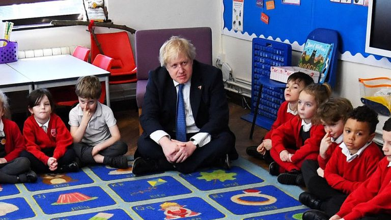HASTINGS, ENGLAND - MARCH 08: UK Foreign Secretary Boris Johnson sits with Year 1 pupils from the Stingray class during a visit to St Leonard's Church of England Primary Academy on March 8, 2018 in Hastings, England. (Photo by Dylan Martinez - WPA Pool/Getty Images)