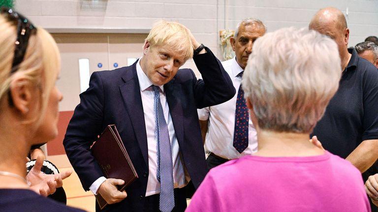 Boris Johnson meeting local people and rescue crews near Whaley Bridge