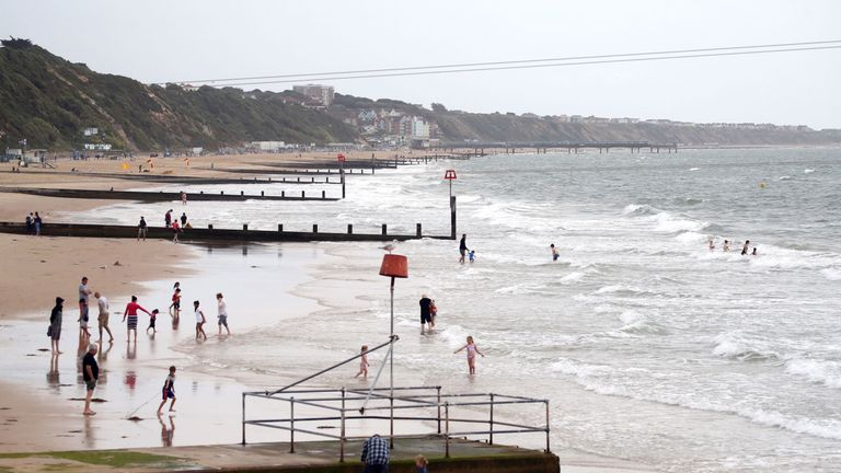 Warnings for rain and wind were issued across nearly all of the UK on Friday, but that didn't stop people going to Bournemouth beach