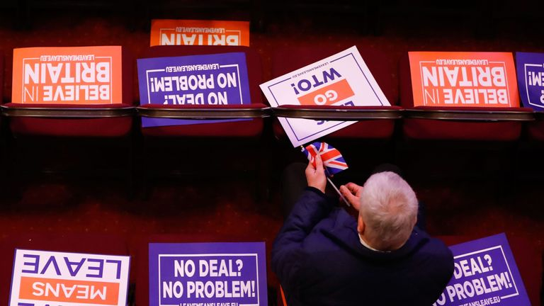 "TOPSHOT - Attendees take their seats covered in placards at a political rally entitled 'Lets Go WTO' hosted by pro-Brexit lobby group Leave Means Leave in London on January 17, 2019. - British Prime Minister Theresa May scrambled to put together a new Brexit strategy on Thursday after MPs rejected her EU divorce deal and demanded that she rule out a potentially disastrous ""no-deal"" split."