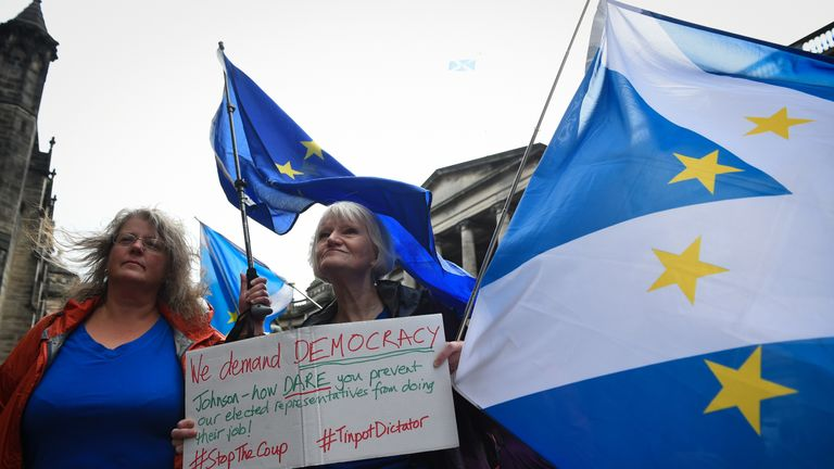 A protester demonstrates against Boris Johnson's decision to suspend parliament outside the Court Of Session in Edinburgh
