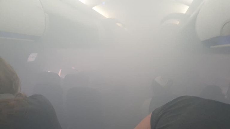 Photos have been posted by frightened passengers showing the cabin full of smoke. Pic: Twitter/@lucyaabrown