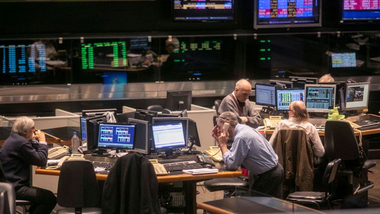 Traders work at the Buenos Aires Stock Exchange on August 12, 2019 in Buenos Aires, Argentina. Buenos Aires Stock Exchange operated today with panic and uncertainty after the reactions of the market, and Argentine Peso's substantial weakening following the Primary Presidential Elections.