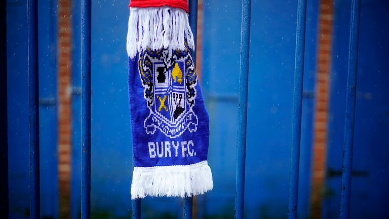Football scarves have been left outside the club