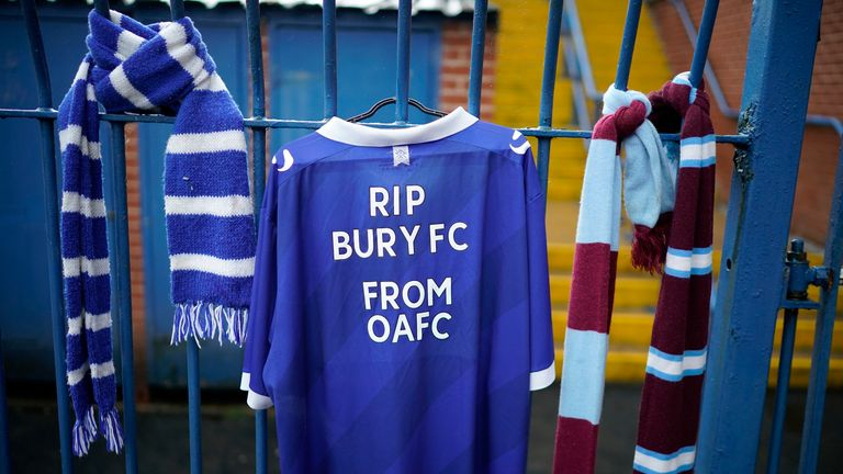 Football scarves hang from the locked gates of Gigg Lane Stadium the home of Bury Football Club who have been expelled from the English Football League (EFL)