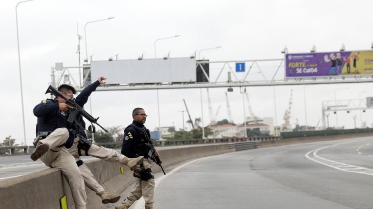 Federal police officers at the Rio-Niteroi Bridge, where armed police surrounded a hijacked passenger bus in Rio de Janeiro, Brazil