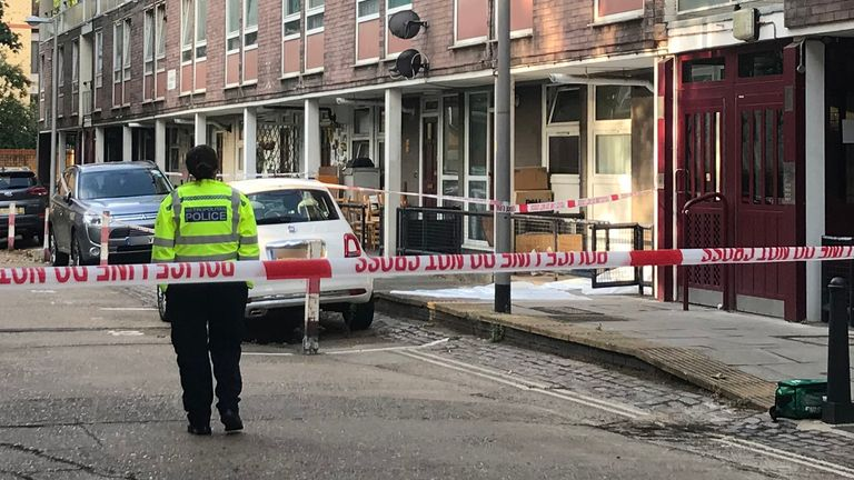 A police officer at the scene of the fatal stabbing in Camden
