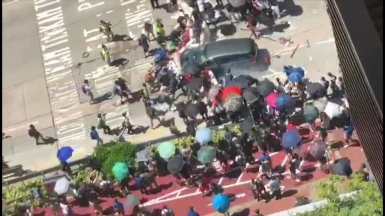 A car drove through a roadblock set up by protesters in Yuen Long after an earlier altercation between the driver and activists.