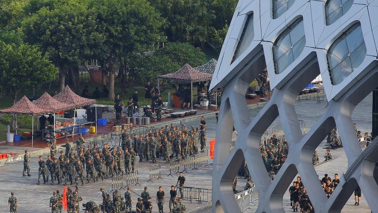 Chinese soldiers walk in formation on the grounds of the Shenzhen Bay Sports Centre in Shenzhen