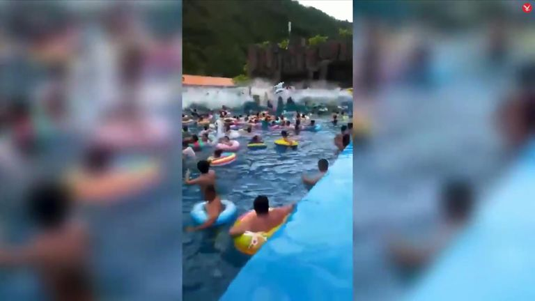A freak wave rips through a 'tsunami pool' in a Chinese water park