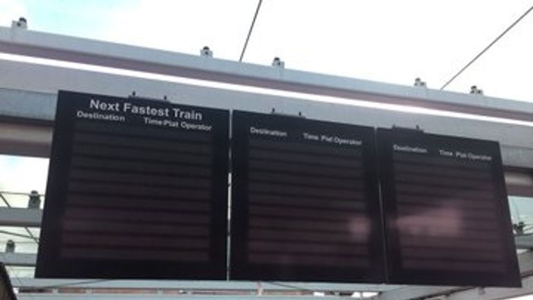 The station boards at Clapham Junction