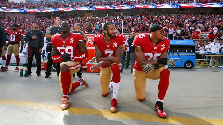 Colin Kaepernick kneels in protest at police brutality against African Americans