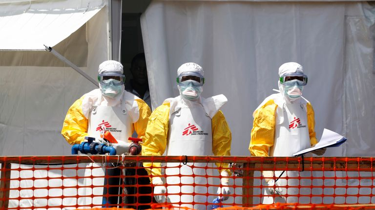 Health workers dressed in protective suits are seen at the newly constructed Ebola treatment centre in Goma, Democratic Republic of Congo
